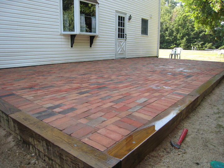 AFTER BRICK PATIO INSTALLTION WITH RAIL ROAD TIE BOARDER