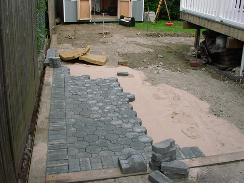 DURING INSTALLATION AND LAYING DOWN PAVER PATIO