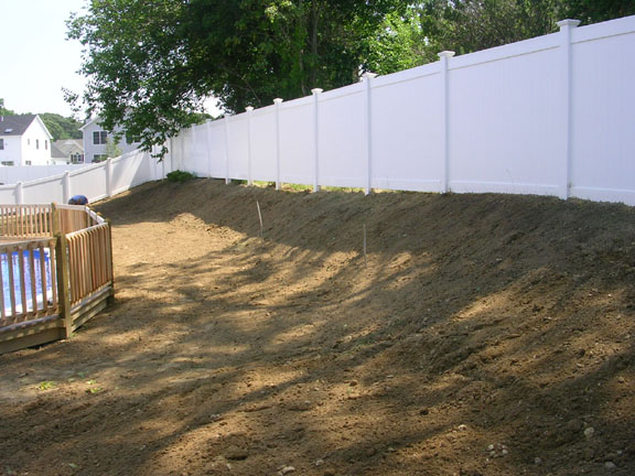 after grading back yard hill along fence 2
